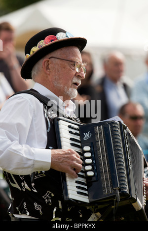 accordion country music bearded man playing - Stock Photo