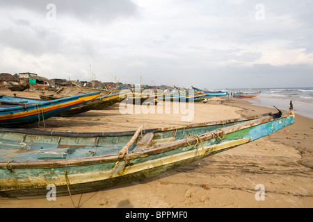 Fishing boats on the beach dusring the rest day at the fisherman village in Puri, Orissa, India. - Stock Photo