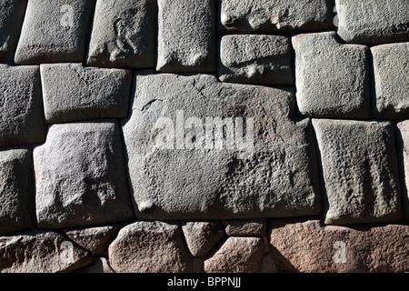 The famous 12 cornered stone in an Inca wall in Calle Hatunrumiyoc, Cusco, Peru - Stock Photo