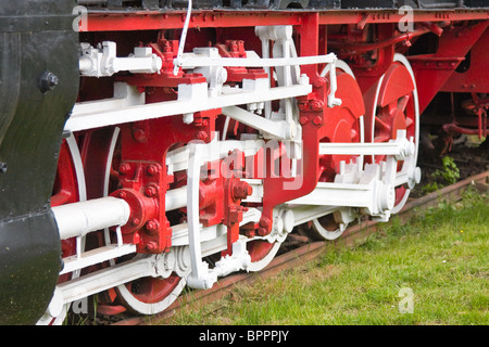 Close up of the wheels of a steam train locomotive at Resita Train Museum in Romania. - Stock Photo