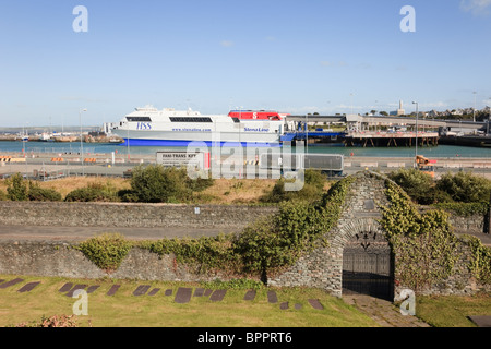 Holyhead, Isle of Anglesey, North Wales, UK. HSS StenaLine ferry in port from churchyard of Saint Cybi in Caer Gybi - Stock Photo