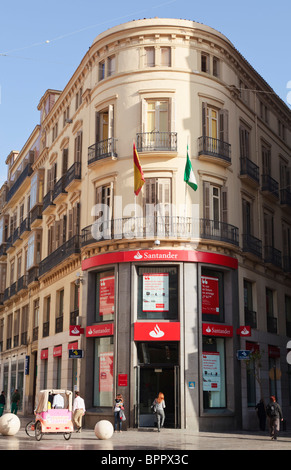 Branch of the Spanish Santander bank in Calle Larios, Malaga, Malaga Province, Spain. - Stock Photo