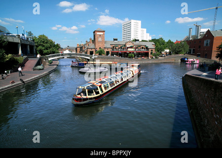 A tourist barge passes Old Turn Junction on the Birmingham canal network - Stock Photo