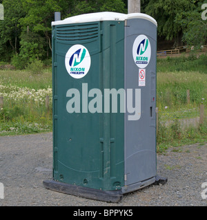 Close Up of a Portable Toilet in a Public Carpark - Stock Photo