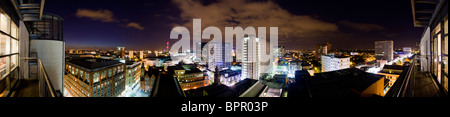 Wide panoramic view of central Birmingham, near Broad Street, at night. - Stock Photo