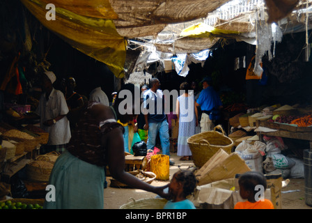 Tourists in covered market, Lamu town, Lamu Island, Kenya - Stock Photo