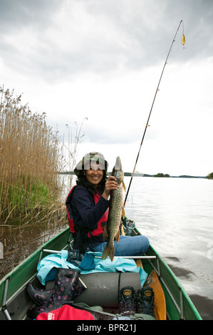 Girl with a a Northern Pike, Esox lucius, caught in the lake Vansjø in Østfold, Norway. Vansjø is a part of the - Stock Photo