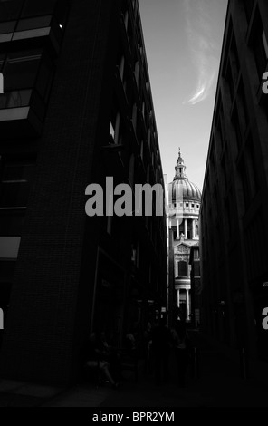 Looking up an alley of the Paternoster Square development to the St Paul's Cathedral, City of London, UK - Stock Photo