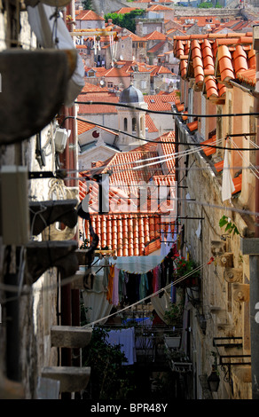 DUBROVNIK, CROATIA. A view down a street in the old walled town, with the Orthodox Church visible in the middle - Stock Photo