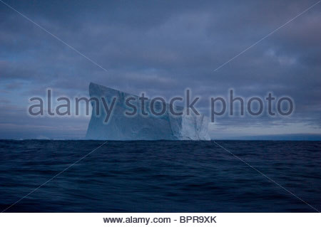 Ice floats off of the waters of Antarctica. - Stock Photo