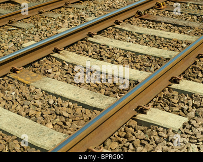 Close up of railway lines and sleepers England UK United Kingdom GB Great Britain - Stock Photo