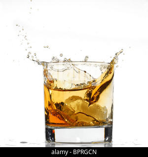 Whiskey splash studio isolated on white background - Stock Photo