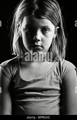 Powerful Black and White Shot of a Sad Looking Child - Stock Photo