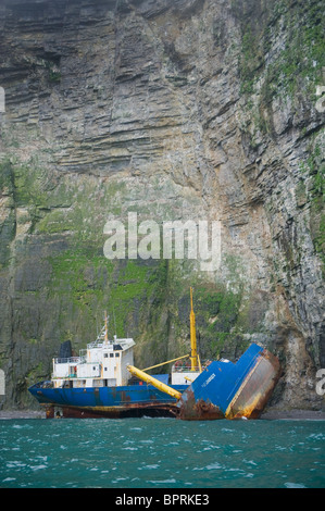 Russian Freighter, wrecked and broken on seabird cliffs, Bear island, Barents Sea, Norway - Stock Photo