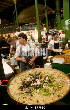 Thai curry dish on sale at stall in Borough Market Southwark London England - Stock Photo