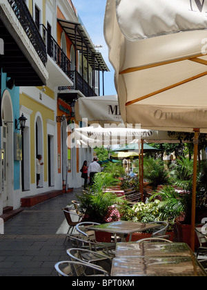 Colorful Buildings and Sidewalk Cafes on Calle Recinto Sur San Juan, Puerto Rico - Stock Photo