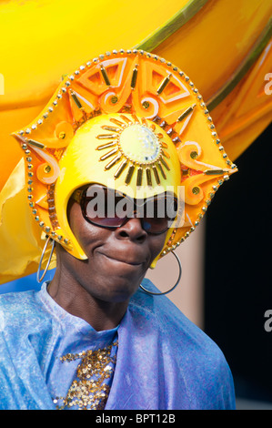Woman in colourful costume at the Notting Hill carnival. - Stock Photo
