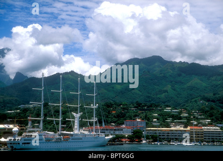 A cruise yacht moored in Papeete harbour, Tahiti - Stock Photo