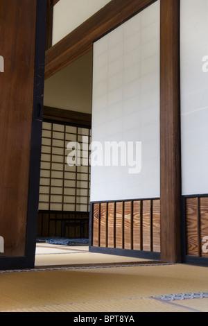 Traditional Japanese Zen Interior, including tatami mats, washi and shoji. Japan. - Stock Photo