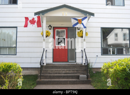 The flags of Nova Scotia and Canada are seen flying outside the home of a patriotic Canadian in Lunenburg, Nova Scotia, Canada.