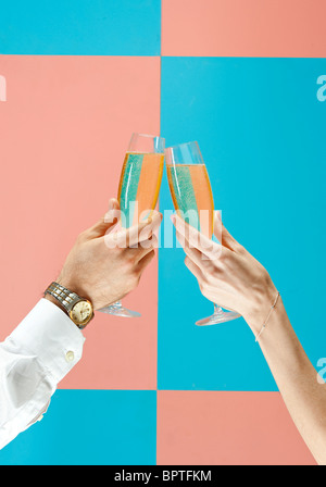 man and woman toast champagne - Stock Photo