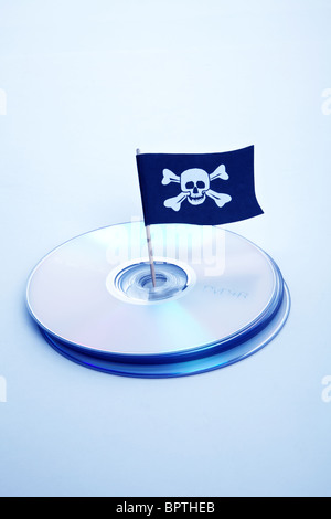CD, DVD and Pirate Flag, concept of Piracy - Stock Photo