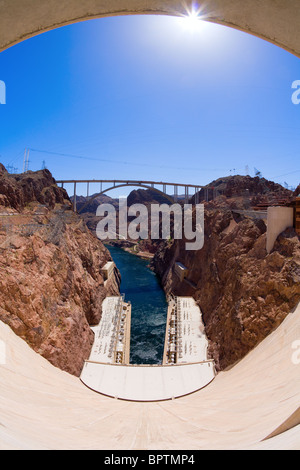 Fisheye view of Hoover Dam and a bypass bridge under construction - Stock Photo