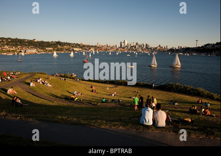 People picnicking at Gas Works Park while enjoying the sailboat racing on Lake Union Seattle Washington State - Stock Photo