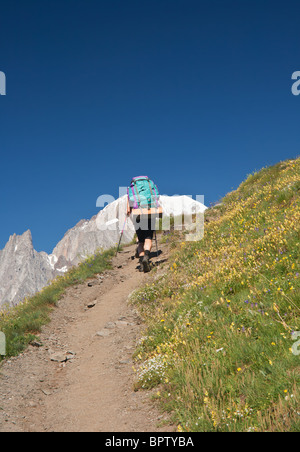 hiker in action with Mont Blanc on background - Stock Photo