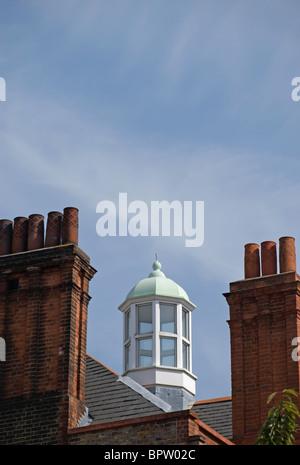 windowed cupola between tudor style redbrick chimneys on a  rooftop in cheyne walk, chelsea, london, england - Stock Photo