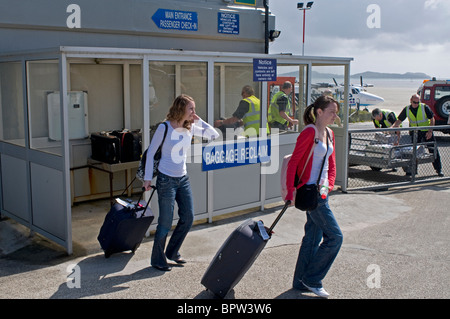 Passenger Luggage collection at Barra Island airstrip,   SCO 6516 - Stock Photo