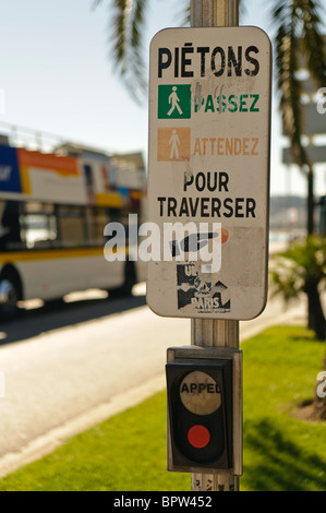 Push button at a French pedestrian crossing. - Stock Photo