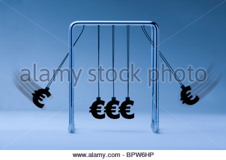 Newtons cradle with euro symbols on blue background - Stock Photo