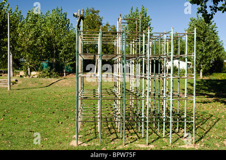 Very old childrens playpark climbing frame in a field - Stock Photo