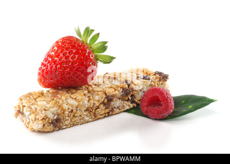 Image of cereal bar and fruits studio isolated on white background - Stock Photo
