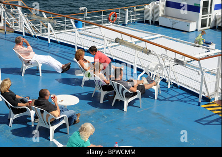 passengers sitting on the deck of brittany ferry cap finistere in the stock photo 80880027 alamy. Black Bedroom Furniture Sets. Home Design Ideas