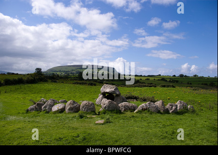 Stone Circle and Domen in Carrowmore Megalithic Cemetery with Knocknarea mountain and queen maeve's cairn behind - Stock Photo