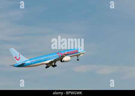 Thomson Boeing 757-200 aircraft climbing out - Stock Photo