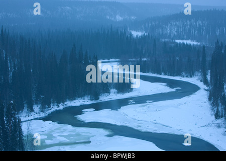 The Kitka River in a snowstorm in Oulanka National Park, Finland. - Stock Photo