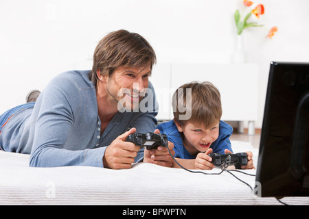 Father and son playing a video game - Stock Photo