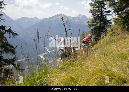 Young girls roaming through the Alps - Stock Photo
