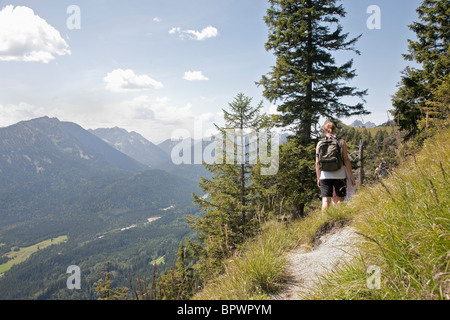 Hiking the trails through the mountains - Stock Photo