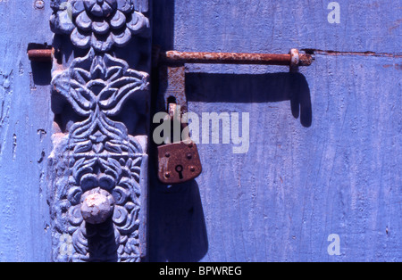 Detail of wooden engraving on a locked door in Stone Town, Zanzibar, Tanzania. - Stock Photo