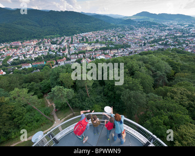 A family looks toward the Black Forest from the Schlossbergturm (castle hill tower) at Freiburg im Breisgau / Southern - Stock Photo