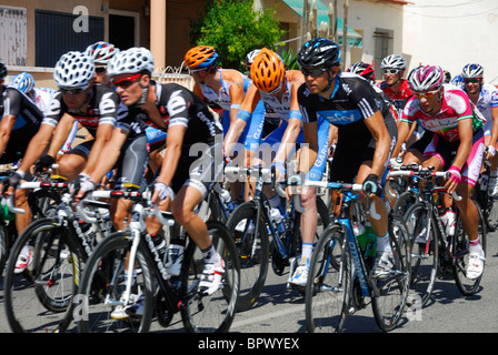 Cyclists taking part in the Vuelta De Espana passing through Catral, Spain - Stock Photo