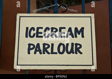Icecream Parlour sign hanging on a chain View from the front. Close up (macro) - Stock Photo
