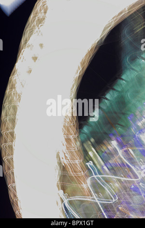 Abstract light streams captured at night using pan and shift method. - Stock Photo