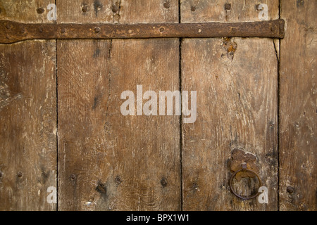 Ancient wooden door detail full frame background texture close up - Stock Photo
