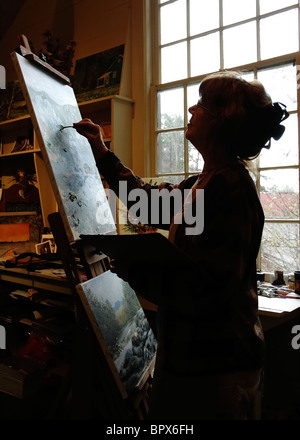 artist at work in her studio along the Great Smoky Arts & Crafts Community loop road Gatlinburg Tennessee - Stock Photo