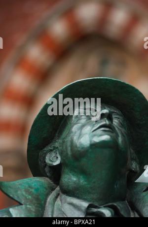 Statue of Sir John Betjeman at St. Pancras Train Station - Stock Photo
